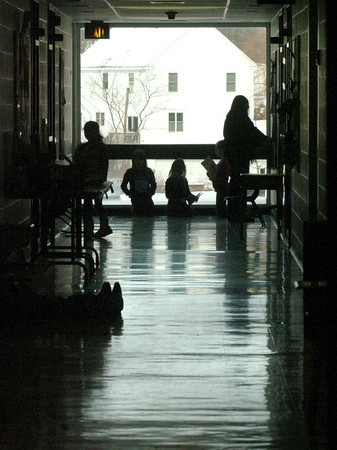 Amesbury: Some students at Amesbury Elementary School do some quiet reading at the end of the hallway only a glass window seperating them from the cold and wind outside. Area schools held recess indoors due to the unseasonable cold. Bryan Eaton/Staff Photo