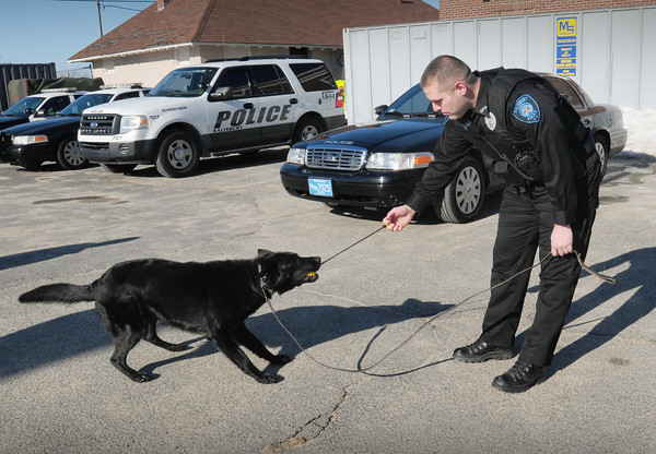 Salisbury: Salisbury police canine officer Rich Dellaria with his dog, Herc. Bryan Eaton/Staff Photo