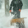 Newburyport: With only his eyes peering through his winter attire, Kevin Kozuchowski snowblows in front of his Water Street home in Newburyport yesterday afternoon. Bryan Eaton/Staff Photo