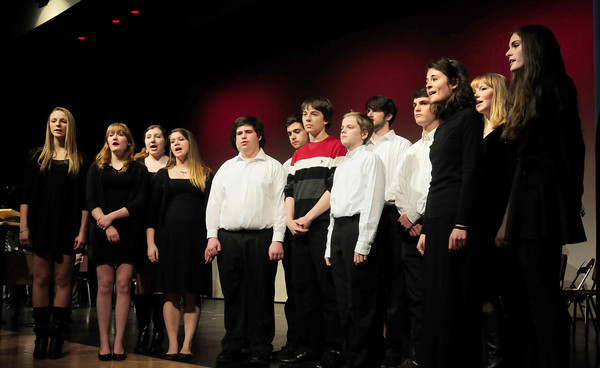 """Amesbury: Amesbury High School's vocal ensemble """"Rhythmics"""" lead attendees to the Mayoral Inauguration in the """"Star Spangled Banner."""" Bryan Eaton/Staff Photo"""
