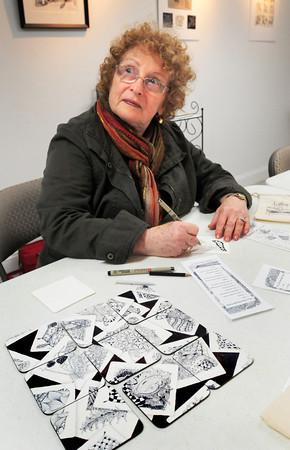 Salisbury: Lisette Kaplowitz of Newburyport listens to Zentangle instructor Donna Scott for the next step of design. Bryan Eaton/Staff Photo
