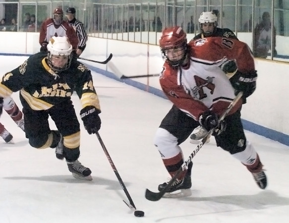 Haverhill: Amesbury's Connor Stevens goes after the puck with North Reading's Corey Collins. Bryan Eaton/Staff Photo