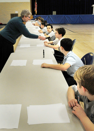 Newburyport: Immaculate Conception English lanquage arts teacher Elyse Cookson leads the school's geography bee on Wednesday for fourth through eighth-graders. The winner will go on to the state level and if wins there, goes on to the nationals. Bryan Eaton/Staff Photo
