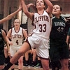 Newburyport: Newburyport's Mary Pettigrew jumps for two points against the Hornet's last night. Bryan Eaton/Staff Photo