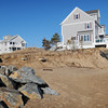 Newbury: Waves from the last storm scoured this area that didn't have protected rocks on Plum Island. The home of 29 Annapolis Way stood on this spot until it was moved across the street back in October. Bryan Eaton/Staff Photo
