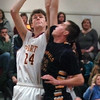 Newburyport: Newburyport's Jeff Martin gets fouled by a Lynnfield player. Bryan Eaton/Staff Photo