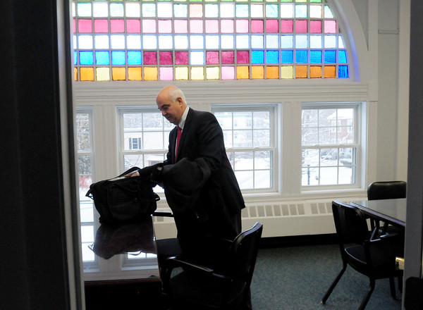 Amesbury: Amesbury Mayor Ken Gray sets his briefcase onto his desk after just entering his office for the first time as mayor after his swearing in yesterday. Bryan Eaton/Staff Photo