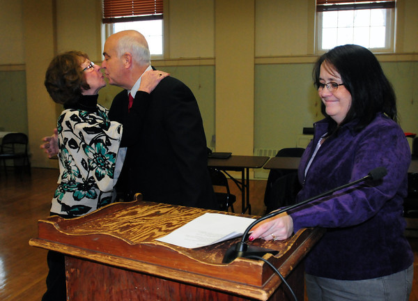 Amesbury: New Amesbury Mayor Ken Gray gets a kiss from his wife, Donna, after being sworn in by city clerk Bonnijo Kitchin, right. Bryan Eaton/Staff Photo