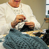 "Amesbury: Mae Kelleher works on knitting a sweater at the Amesbury Senior Center on Tuesday morning in the activity ""Busy Needles."" The participants make sweaters, hats and scarves for different agencies who distribute them to needy children. Bryan Eaton/Staff Photo"