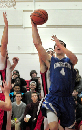 Amesbury: Georgetown's Patrick Bjork tries for two points as Amesbury's Patrick Scanlon defends. Bryan Eaton/Staff Photo