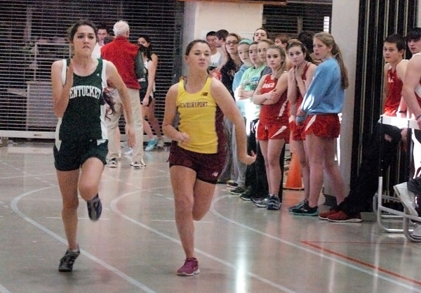 Ipswich: Pentucket's Katryn Dwyer, left, and Newburyport's Erin Filetti in the 40 yard dash. Bryan Eaton/Staff Photo
