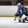 Newburyport: Triton goalie Devon Shuman deflects the puck in action against Saugus last night at the Graf Rink. Bryan Eaton/Staff Photo