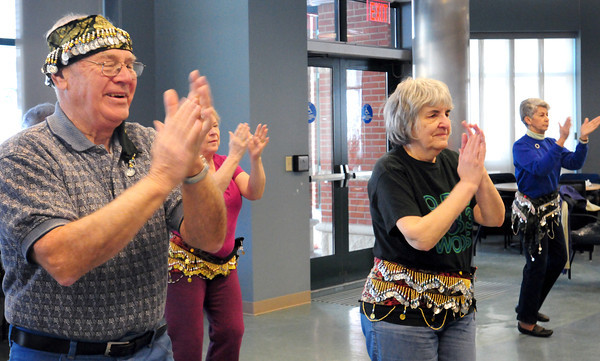 Amesbury: Rob Dylingowski, the only gentleman in a Zumba class, wears the showy belt on his head as the ladies wear theirs around their waists. The excercise class was held at the Amesbury Senior Center on Thursday where classes are held a couple times a month and taught by Kerstin Olson. Bryan Eaton/Staff Photo