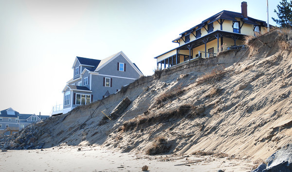 Newbury: Erosion in front of Bennett Hill cottage from last week's storm. Bryan Eaton/Staff Photo