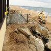 Newbury: The installation of boulders up to the porch of the Bennett Hill cottage on Plum Island has been completed. The cottage was threatened by erosion during the storm earlier this month. Bryan Eaton/Staff Photo