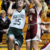 West Newbury: Pentucket's Carolyn Modlish shoots past Newburyport's Morgan Johnston. Bryan Eaton/Staff Photo