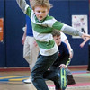Newburyport: Kai Gillingham, 6, and other first-graders at the Bresnahan School jump in 180 turns in physical education class on Monday. The students were doing excercises teaching rotation, static balance and flight. Bryan Eaton/Staff Photo