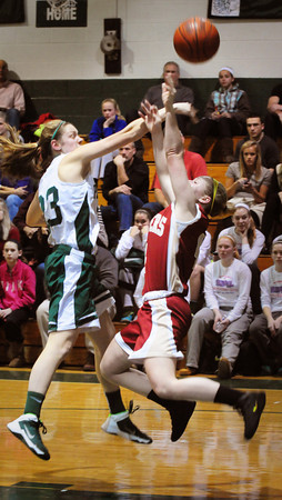 West Newbury: Pentucket's Kilian McKenna, left, shoots as the Clipper's Amy Sullivan tries to block the shot. Bryan Eaton/Staff Photo