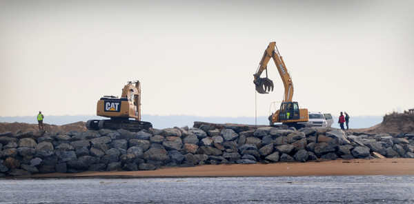 Newburyport: Heavy equipment can be seen working on the south jetty on Plum Island from Salisbury Beach State Reservation. Bryan Eaton/Staff Photo