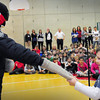 """Amesbury: Garrett Bailey, 6, takes the gloves off of """"Officer Ralph"""" in front of the Cashman School body not knowing it's his father, Amesbury police Sgt. Craig Bailey, who just returned from US Coast Guard service in Cuba. Bryan Eaton/Staff Photo"""