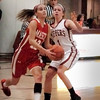 Newburyport: Masconomet's Hannah Kiernan attempts two points guarded by Newburyport's Aly Leahy. Bryan Eaton/Staff Photo