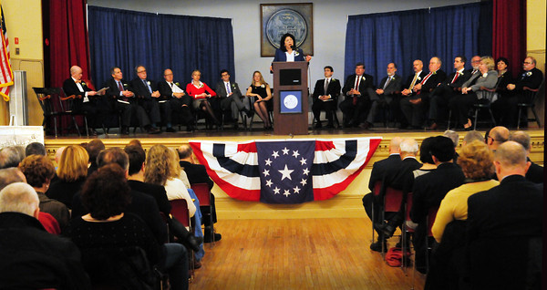 Newburyport: Flanked by city council and school committee members, Mayor Donna Holaday gives her Inaugural Address at Newburyport City Hall late yesterday morning. Bryan Eaton/Staff Photo