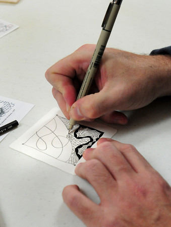 Salisbury: Robert Connolly of Salisbury works on a Zentagle design. Bryan Eaton/Staff Photo