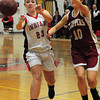Amesbury: Amesbury's McKenzie Cloutier passes the ball before the Clipper's Emily Pettigrew can put on the pressure. Bryan Eaton/Staff Photo