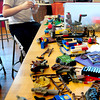 "Newburyport: Cam Taylor, 9, has a table full of Lego's to work with at the Kelley School Youth Center on Thursday afternoon. He was making a battle scene with models of Teenage Mutant Ninjas and ""shredders."" Bryan Eaton/Staff Photo"