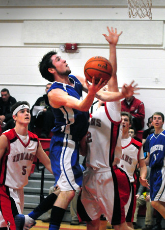 Amesbury: Georgetown's Matt Gott misses the two points as he's guarded by Amesbury's Patrick Scanlon, left, and Jack Fortin. Bryan Eaton/Staff Photo