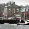 Newburyport: The fishing boat Katie May makes its way past the Custom House Maritime Museum in Newburyport past ice floes heading out to sea yesterday afternoon as it headed to the embayment area. The photo was taken from the Salisbury Town Pier on Ring's Island. Bryan Eaton/Staff Photo