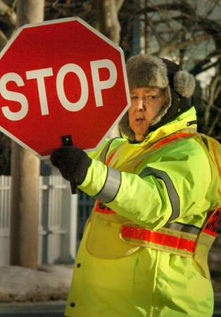 Newburyport: Bresnahan School crossing guard Burt Gilbert is one of those who bundle up well in the cold weather that has held a grip on the area of late. Relief is on the way starting today and temperatures in the mid-40's and even 50's are in the forecast for the weekend and early next week. Bryan Eaton/Staff Photo