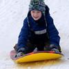 newburyport: Finn Twichell, 12, flys down the sledding hill at the Winter Carnival at the Bartlet Mall Saturday in Newburyport. Jim Vaiknoras/staff photo
