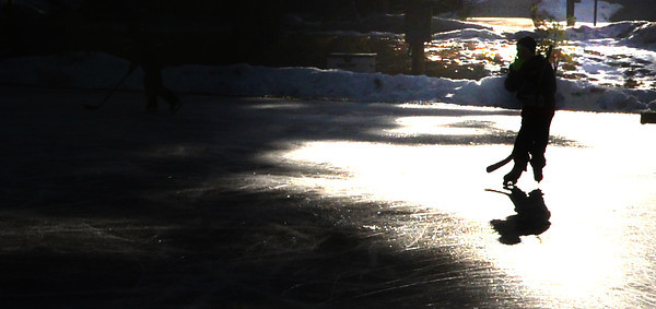 Amesbury: A skater cast a shadow while playing hockey at Amesbury Park Wednesday afternoon. Jim Vaiknoras/staff photo