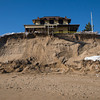 Newburyport: A 25 ft cliff of sand on the ocean side of the Bennet Hill Cottage on Plum Island. Jim Vaiknoras/staff photo