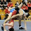 Georgetown:Georgetown wrestler Constantine Galanis flips Saugus's Seth Roy at Georgetown High Saturday. jim Vaiknoras/staff photo