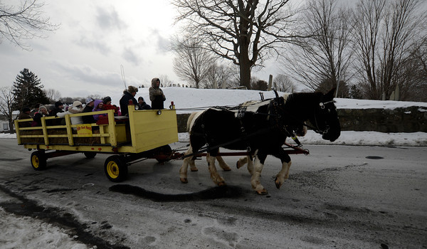 newburyport: People enjoy hay rides with the Colby Draft Horse of Amesbury at the Winter Carnival at the Bartlet Mall Saturday in Newburyport. Jim Vaiknoras/staff photo