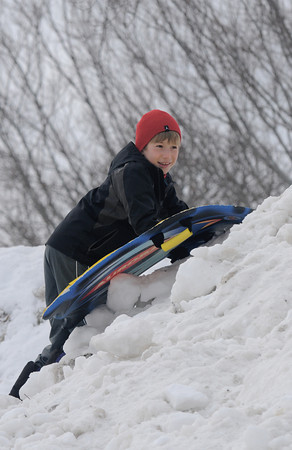 newburyport: Caelan Twichell, 9, drags his sled as he climb up the sledding hill at the Winter Carnival at the Bartlet Mall Saturday in Newburyport. Jim Vaiknoras/staff photo