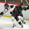 Newburyport: Newburyport's Tyler Therrien is checked by Pentucket's Patrick Slack during their game Saturday at the Graf Rink in Newburyport. Jim Vaiknoras/staff photo