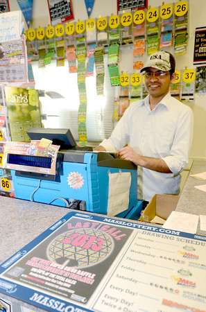 Salisbury: Jay Patel works the lottery machine at Dick's Variety in Salisbury. The store sold a winning lottery ticket. Jim Vaiknoras/staff photo