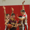 Amesbury: Newburyport's Drew Bourdeau is surrounded by Amesbury player during their game at Amesbury High Friday night. Jim Vaiknoras/staff photo
