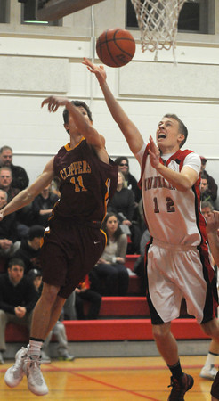 Amesbury:  Amesbury's Jack Fortin shot is blocked by Newburyport's Mike Shay during their game at Amesbury High Friday night. Jim Vaiknoras/staff photo