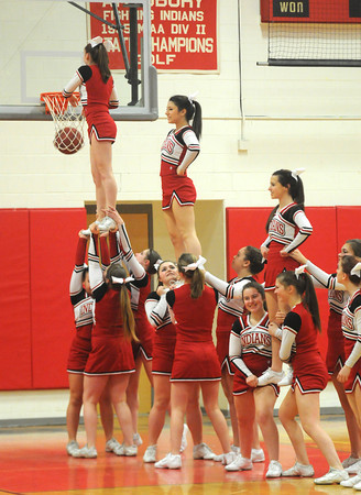 Amesbury: The Amesbury High basketball cheerleaders dunk a basketball as part of their ruoteen during Friday night game against Pentucket at Amesbury high. Jim Vaiknoras/staff photo