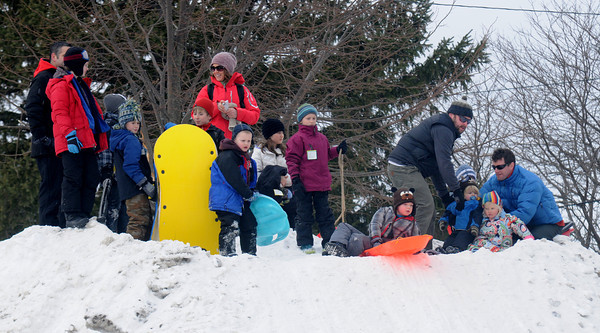 newburyport: People cue up for their turn at the sledding hill at the Winter Carnival at the Bartlet Mall Saturday in Newburyport. Jim Vaiknoras/staff photo