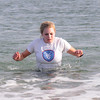 Salisbury: Leah Staschke goes for a swim Wednesday after running in the 33rd annual Hangover Classic at Salisbury Beach. Jim Vaiknoras/staff photo