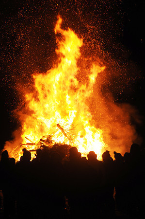 Londonderry:People keep warm on a cold January night at the 19th annual bonfire at Mack's Apples in Londonderry Saturday night.Jim Vaiknoras/staff photo