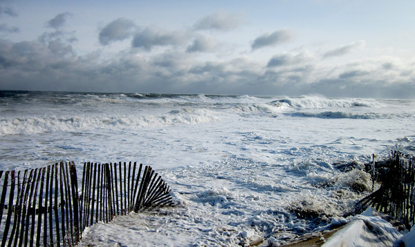 Salisbury: Fierce waves pound at the beach along Ocean Front at Salisbury Beach. Handfuls of people stopped briefly to watch the surf and photograph it, then quickly made their escape from the sub-zero temperatures.John Macone/Staff photo
