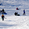 Newburyport: Sledders enjoy a brief warm up Sunday on March's Hill in Newburyport. Jim Vaiknoras/staff photo
