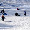 Newburyport: Sledders enjoy a brief warm up Sunday on March's Hill in Newburyport. Jim Vaiknoras/staff photo