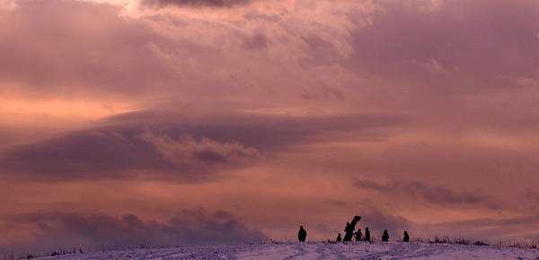 Amesbury: Sledders enjoy the snow at Woodsom Farm under a changing winter sky Monday afternoon. Jim Vaiknoras/staff photo
